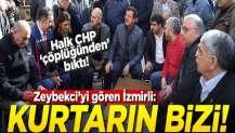 Zeybekci'yi gören İzmirli: Kurtarın bizi!